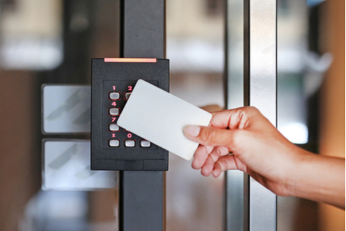 Person holding card to keypad