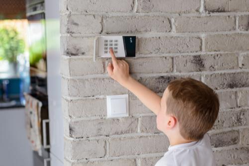 Youth programming a burglar alarm